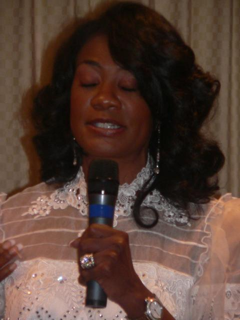 Brenda Jefferson shares her testimony at the album release party.