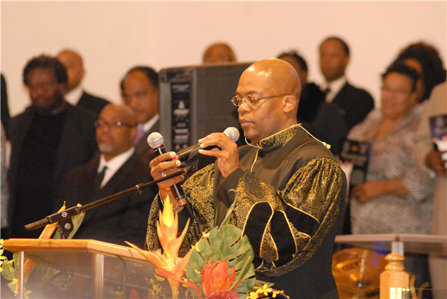 Pastor Bernard Jakes brings the services to order