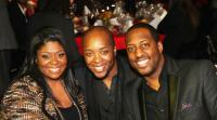 Kim Burrell, Eric Dawkins and Isaac Carree pause for a photo