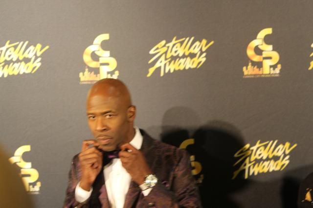 Ricky Dillard adjusts his bow tie for his close up