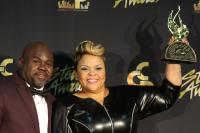 David and Tamela Mann pose with one of her Stellar Award Trophies
