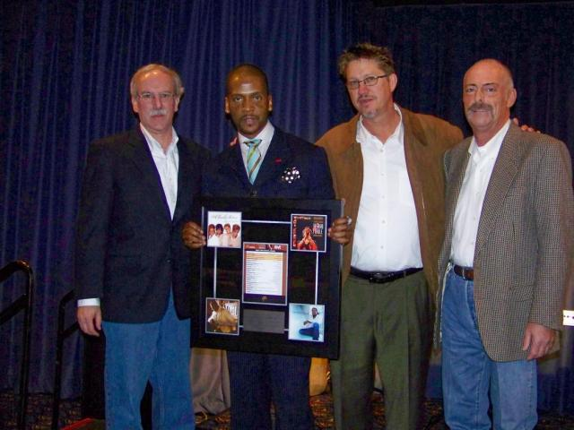 Donald Lawrence receives his award from Ken Pennell, Larry Blackwell, and Billboard's representative