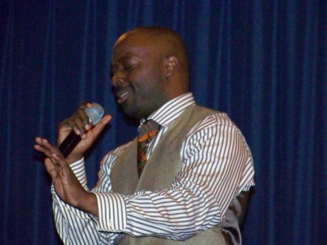 Myron Butler singing with passion