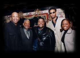 Montell Jordan with Donnie McClurkin and Darwin Hobbs, at the BMI Luncheon with BMI executives in Atlanta during the Stellar Awards weekend, January 2002.