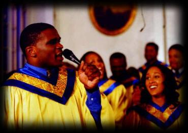 Darius McCrary (as Tommy Blessed) and  Tamara Mowry (as Lilly), singing in the choir
